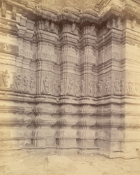 Close view of base of shrine wall of Changdeva Temple, Changdeva, showing moulding and sculpture details
